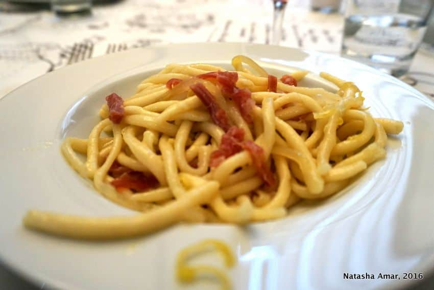 strozzapretti pasta in Bologna, Italy. Love Italian food? Take a cooking class in Italy where you'll learn to prepare classic pasta dishes and taste as well. This is a bucketlist worthy experience for foodies traveling to Italy. #Italytravel #Italycookingclass