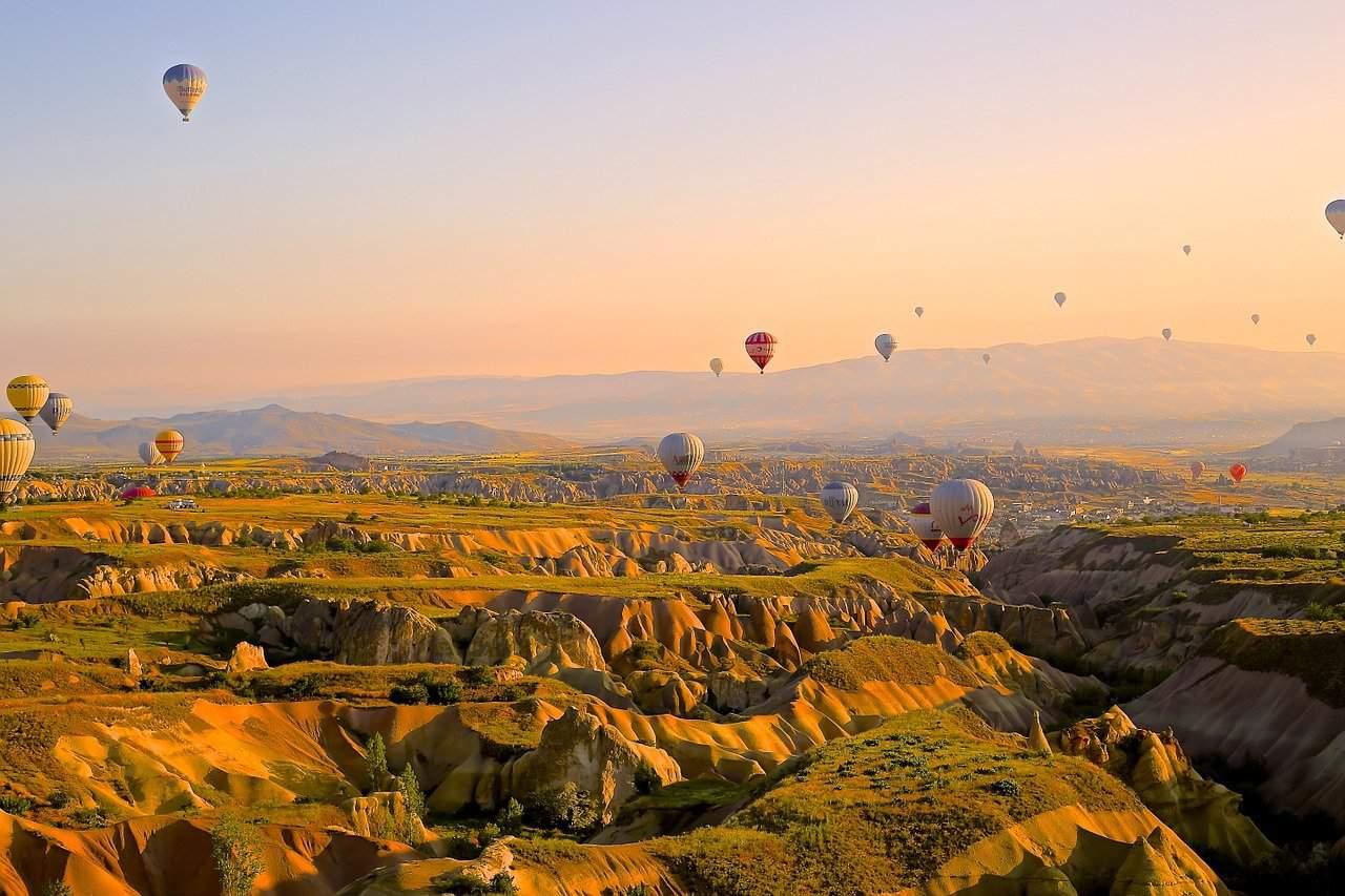 Hot Air Balloons flying over a Martian landscape in Cappadocia